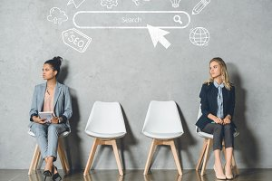 multicultural businesswomen waiting