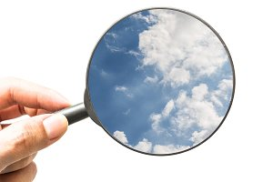 magnifying glass with blue sky