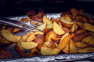 fried potatoes on foil