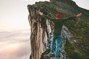Adventurer man on the edge mountain