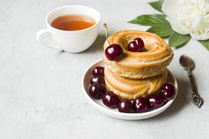 Custard cakes ring with cherry on a
