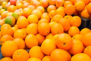 Pile of fresh oranges and mandarins