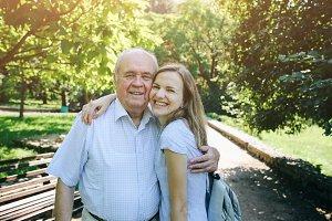 Cute grandpa hugging granddaughter