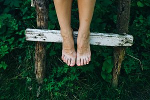 Barefoot girl. Rustic village photo