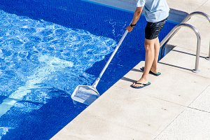 cleaning the swimming pool with a ne