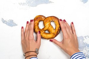 Bavarian pretzel in womans hands