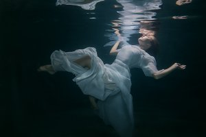 Woman under the water.