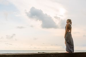 Beautiful lonely in dress at seaside