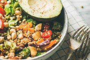 Vegan dinner with avocado, grains