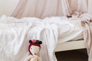 Dolly in a little girl's bedroom