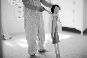 little girls twirling with doll