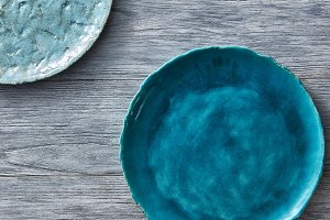 Two porcelain blue bowls on a gray