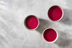 Three bowls with red beet smoothies