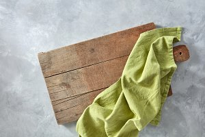 A wooden board with a green kitchen