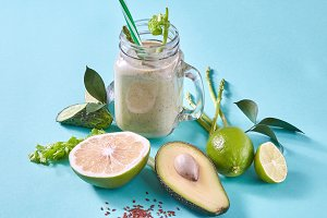 Homemade green smoothies with slices
