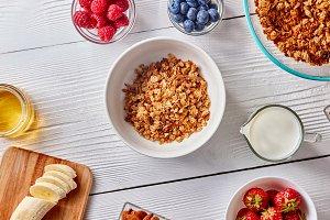 Plate with granola, berries, milk