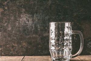 Empty mug of beer on rustic table
