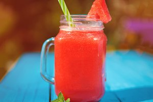 Watermelon lemonade in a glass mug o
