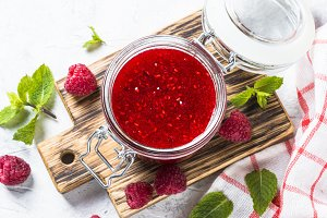 Strawberry jam in glass jar top view