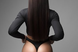 Beautiful athletic ass in thong in a