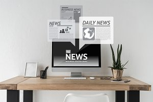 Computer with news on screen