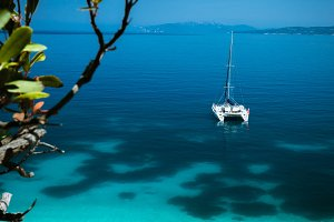 White catamaran yacht at anchor on