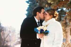 Winter bright wedding bride and groo