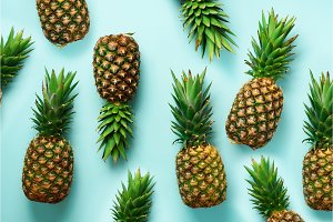 Fresh pineapples on blue background