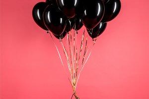 black balloons and shopping bag