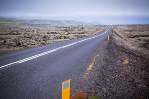 Highway through Iceland landscape at