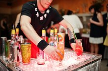 Talented bartender performing tricks