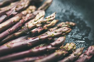 Fresh raw uncooked purple asparagus