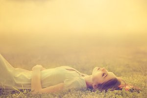 girl lies on a meadow