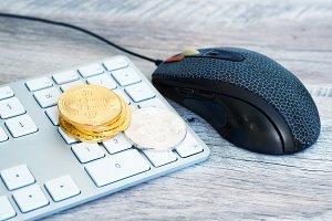 Golden bitcoin on a keyboard