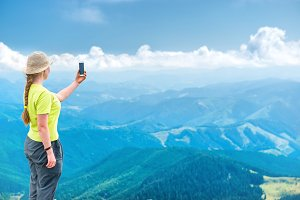 Young woman taking selfie on smartph