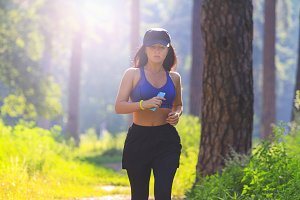 beautiful girl does jogging in park