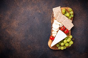 Cheese plate with brie, grape and