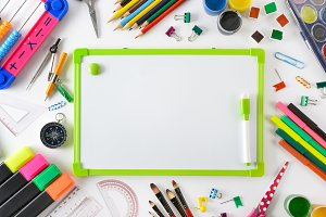 School supplies with flipchart on wh