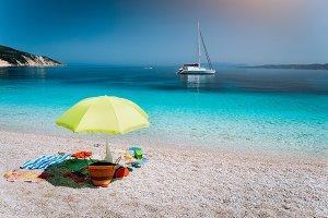 Idyllic white beach with umbrella on