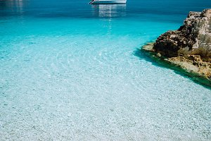 Azure blue lagoon with sailing
