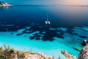 White catamaran yacht at anchor in