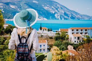 Tourist woman with blue sunhat and