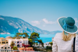 Tourist woman wear blue sunhat and