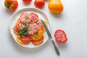 Ripe tomatoe sliced on a plate. Top