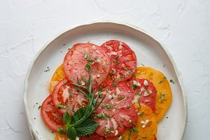 Sliced ripe tomatoes on a plate with
