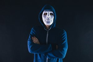 Anonymous masked man under hoodie wi