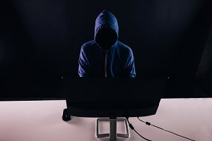 Anonymous and faceless hacker under