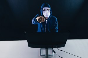 Anonymous masked man under hoodie po