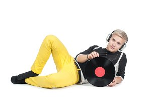 Young man with vinyl record