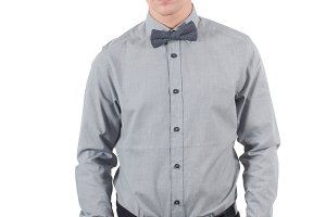 Male in shirt and bow-tie standing